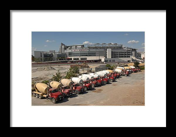 In A Row Framed Print featuring the photograph Colorado Rockies V Washington Nationals by Mitchell Layton
