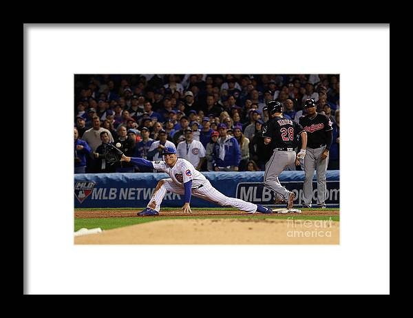 Second Inning Framed Print featuring the photograph Corey Kluber, Anthony Rizzo, and Kris Bryant by Jamie Squire