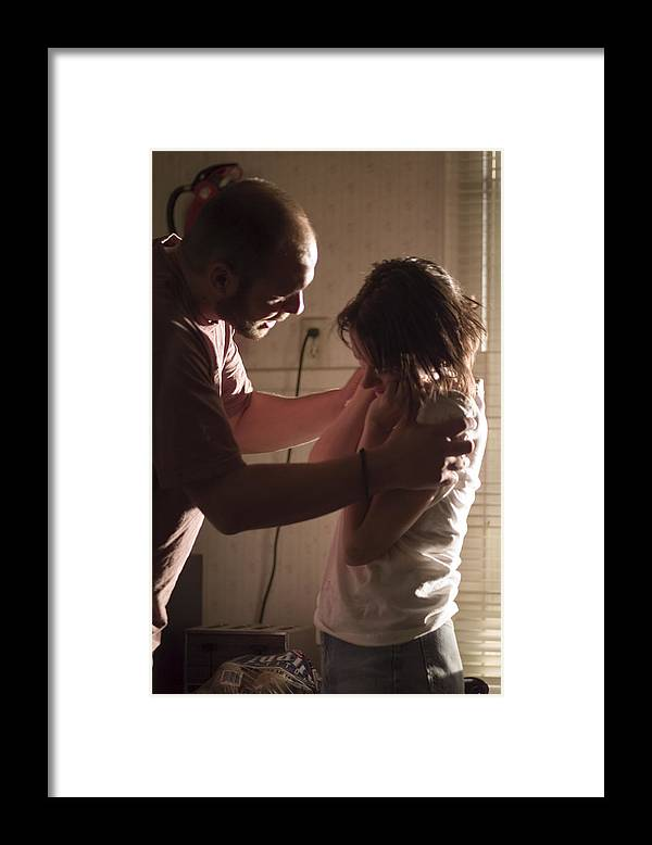 Young Men Framed Print featuring the photograph Couple having fight in kitchen, man holding shoulders of woman by Photodisc