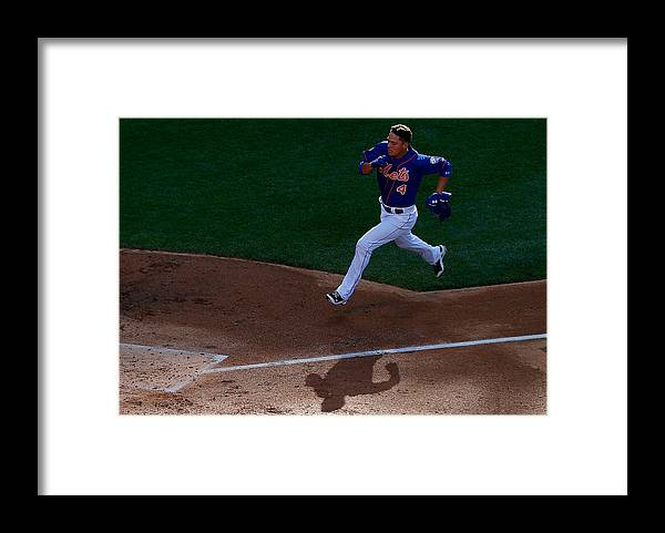 Game Two Framed Print featuring the photograph Daisuke Matsuzaka And Wilmer Flores by Mike Stobe