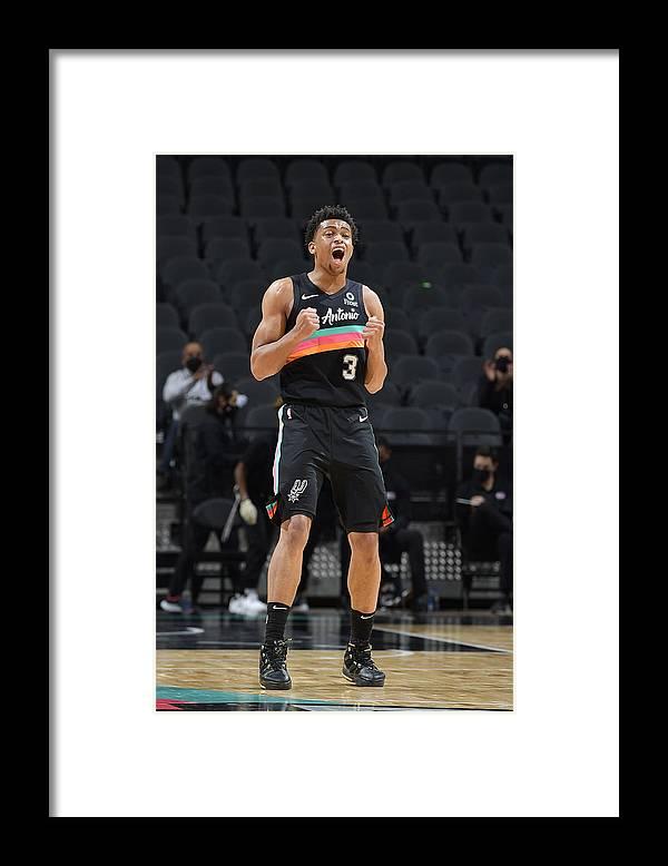 Keldon Johnson Framed Print featuring the photograph Dallas Mavericks v San Antonio Spurs by Logan Riely