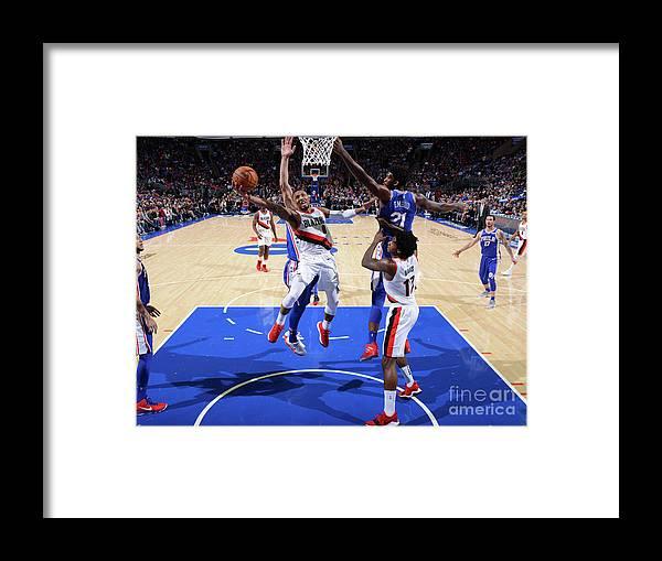 Nba Pro Basketball Framed Print featuring the photograph Damian Lillard by Jesse D. Garrabrant