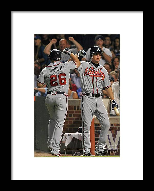 People Framed Print featuring the photograph Dan Uggla and Chipper Jones by David Banks
