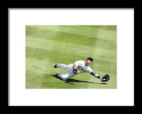 American League Baseball Framed Print featuring the photograph Daniel Robertson and Kole Calhoun by Rick Yeatts