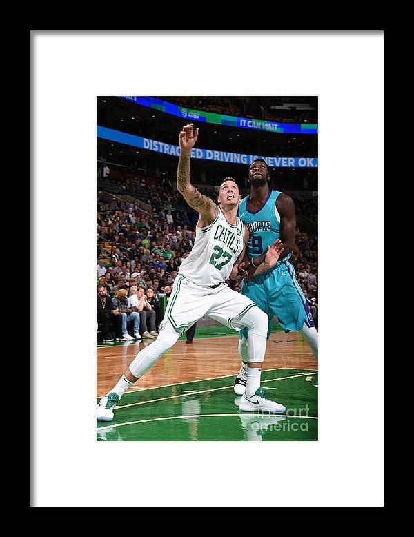 Nba Pro Basketball Framed Print featuring the photograph Daniel Theis and Mangok Mathiang by Brian Babineau