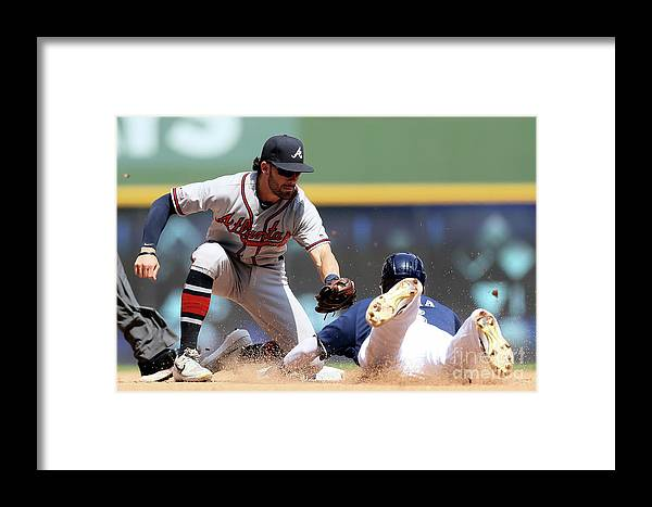 People Framed Print featuring the photograph Dansby Swanson And Orlando Arcia by Dylan Buell