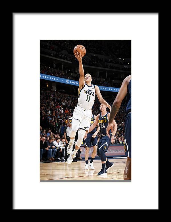 Nba Pro Basketball Framed Print featuring the photograph Dante Exum by Garrett Ellwood