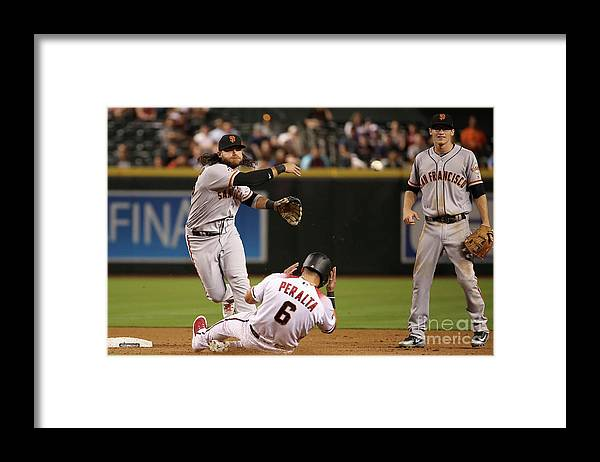 Double Play Framed Print featuring the photograph David Peralta and Brandon Crawford by Christian Petersen