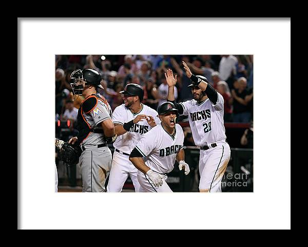 Three Quarter Length Framed Print featuring the photograph David Peralta and Chris Iannetta by Norm Hall