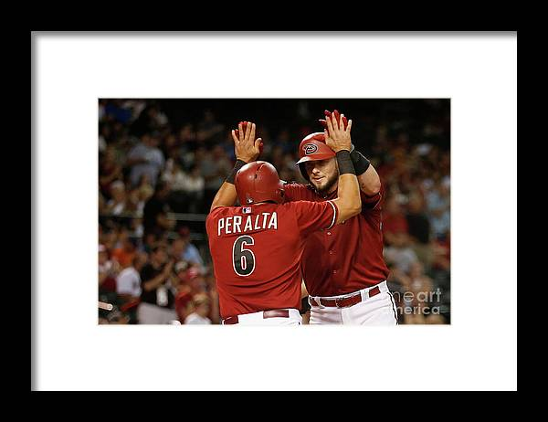 People Framed Print featuring the photograph David Peralta and Jarrod Saltalamacchia by Christian Petersen