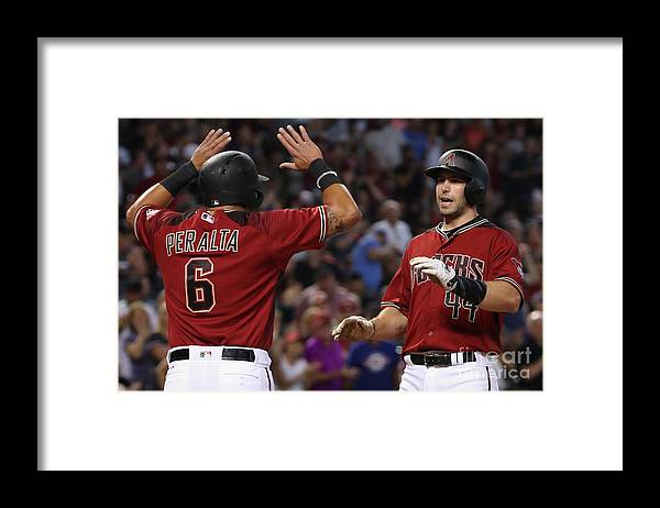 People Framed Print featuring the photograph David Peralta and Paul Goldschmidt by Christian Petersen
