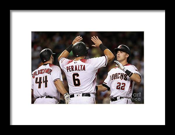 People Framed Print featuring the photograph David Peralta, Paul Goldschmidt, and Jake Lamb by Christian Petersen