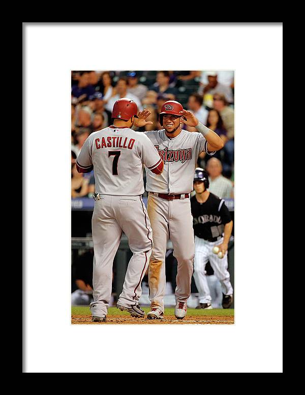 Second Inning Framed Print featuring the photograph David Peralta, Welington Castillo, and Kyle Kendrick by Doug Pensinger