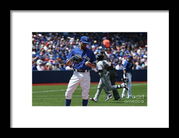 David Price Framed Print featuring the photograph David Price and Torii Hunter by Tom Szczerbowski