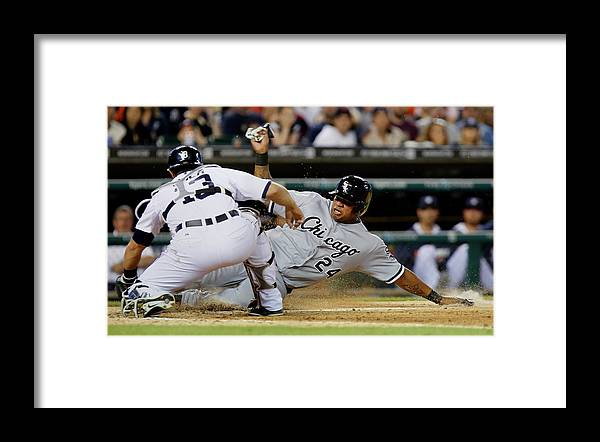 American League Baseball Framed Print featuring the photograph Dayan Viciedo and Alex Avila by Duane Burleson