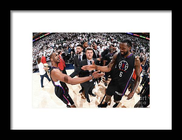 Playoffs Framed Print featuring the photograph Deandre Jordan and Chris Paul by Andrew D. Bernstein