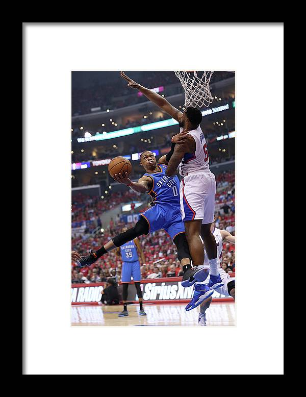 Playoffs Framed Print featuring the photograph Deandre Jordan and Russell Westbrook by Stephen Dunn