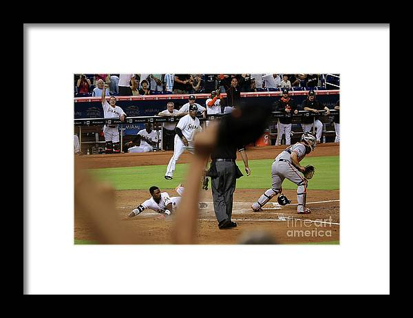 People Framed Print featuring the photograph Dee Gordon and Andrew Susac by Mike Ehrmann