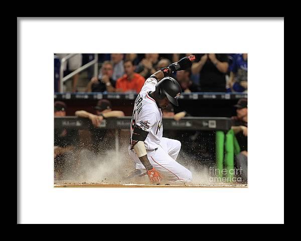 People Framed Print featuring the photograph Dee Gordon and Giancarlo Stanton by Mike Ehrmann