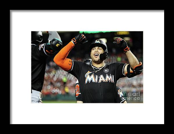 People Framed Print featuring the photograph Dee Gordon and Giancarlo Stanton by Rob Carr
