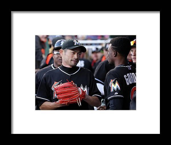 People Framed Print featuring the photograph Dee Gordon and Ichiro Suzuki by Adam Hunger