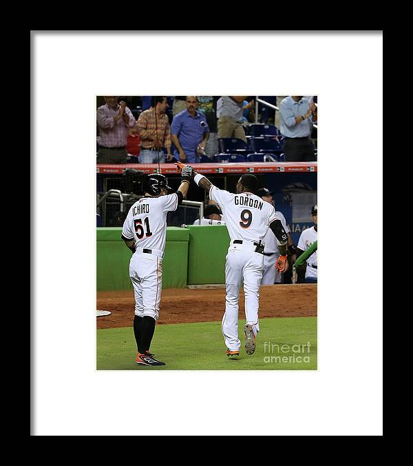 People Framed Print featuring the photograph Dee Gordon and Ichiro Suzuki by Mike Ehrmann