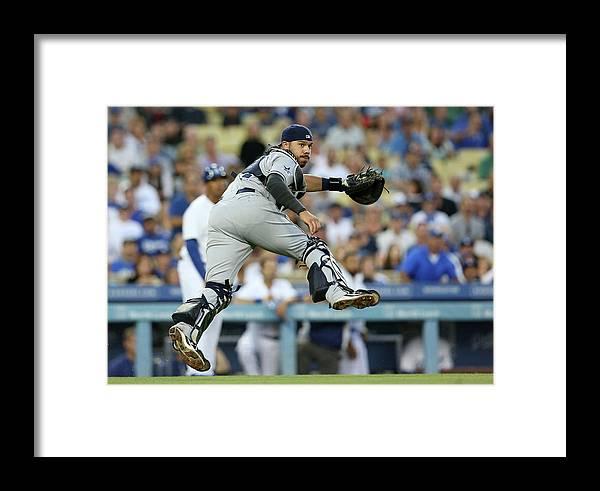 Baseball Catcher Framed Print featuring the photograph Dee Gordon And Rene Rivera by Stephen Dunn