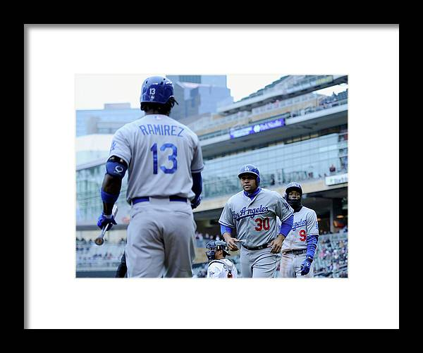 Second Inning Framed Print featuring the photograph Dee Gordon, Hanley Ramirez, and Miguel Olivo by Hannah Foslien