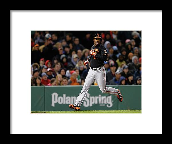 American League Baseball Framed Print featuring the photograph Delmon Young and Matt Wieters by Jim Rogash
