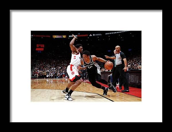 Nba Pro Basketball Framed Print featuring the photograph Demar Derozan and Kyle Lowry by Mark Blinch