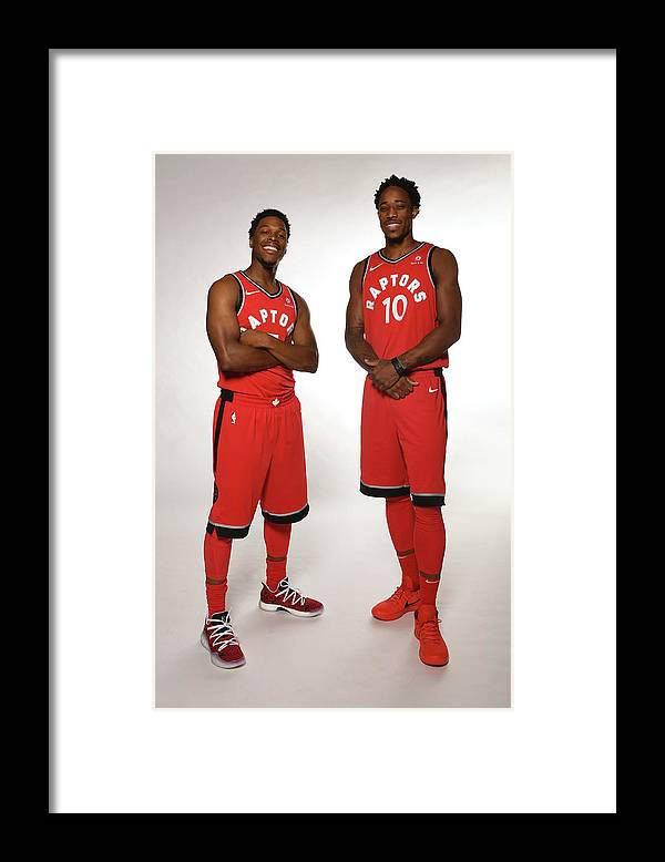 Media Day Framed Print featuring the photograph Demar Derozan and Kyle Lowry by Ron Turenne
