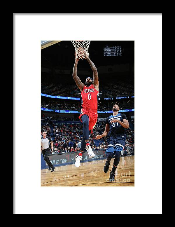 Smoothie King Center Framed Print featuring the photograph Demarcus Cousins and Taj Gibson by Layne Murdoch Jr.