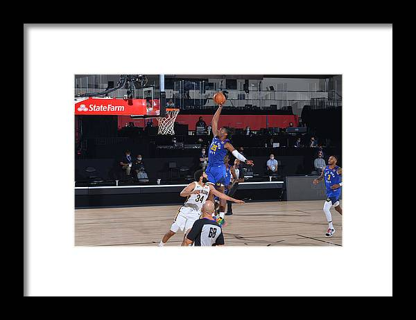 Nba Pro Basketball Framed Print featuring the photograph Denver Nuggets v New Orleans Pelicans by Garrett Ellwood