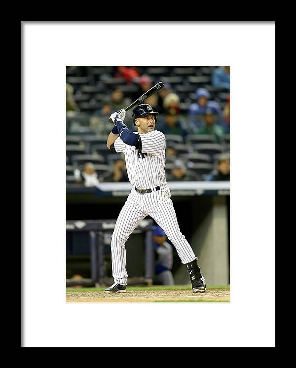 Game Two Framed Print featuring the photograph Derek Jeter by Elsa