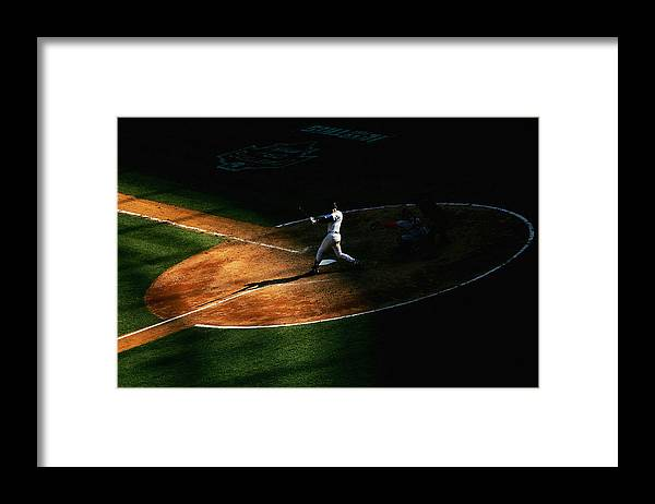 People Framed Print featuring the photograph Derek Jeter by Ezra Shaw