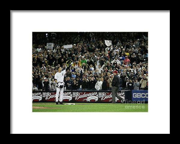 People Framed Print featuring the photograph Derek Jeter by Mike Ehrmann