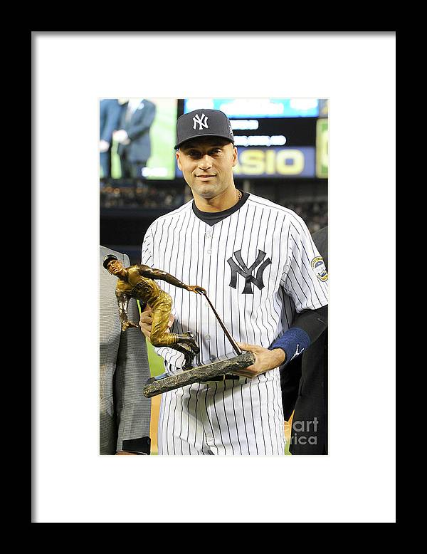 Game Two Framed Print featuring the photograph Derek Jeter by Rich Pilling