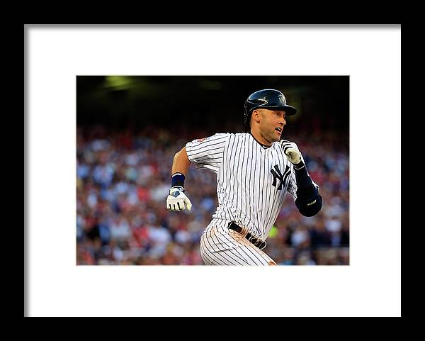 People Framed Print featuring the photograph Derek Jeter by Rob Carr