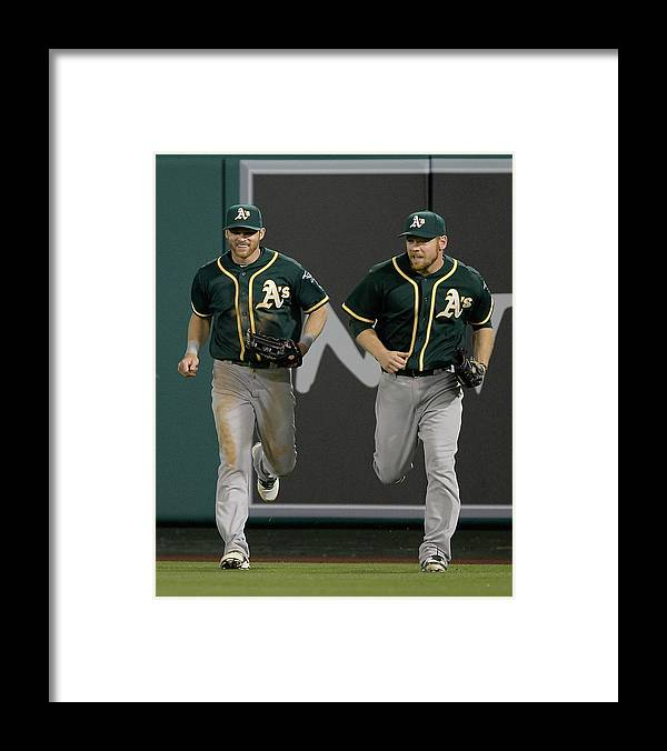 American League Baseball Framed Print featuring the photograph Derek Norris, Howie Kendrick, and Brandon Moss by Harry How