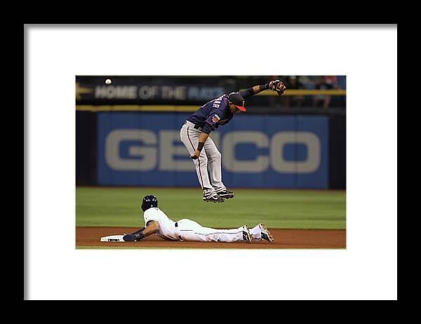 American League Baseball Framed Print featuring the photograph Desmond Jennings and Eduardo Escobar by Scott Iskowitz