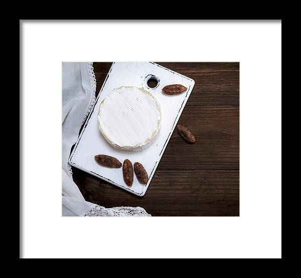 Unhealthy Eating Framed Print featuring the photograph Directly Above Shot Of Dessert With Dried Fruits On Table by Natalya Danko / EyeEm