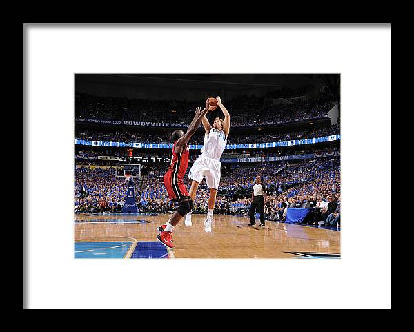 Playoffs Framed Print featuring the photograph Dirk Nowitzki and Joel Anthony by Andrew D. Bernstein