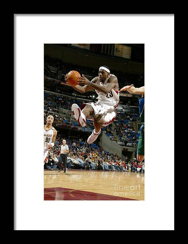 Nba Pro Basketball Framed Print featuring the photograph Dirk Nowitzki and Lebron James by David Liam Kyle