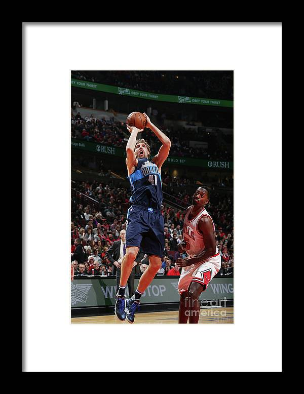 Nba Pro Basketball Framed Print featuring the photograph Dirk Nowitzki by Gary Dineen