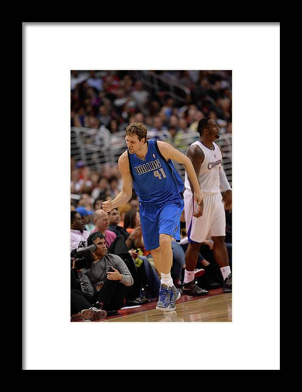 Nba Pro Basketball Framed Print featuring the photograph Dirk Nowitzki by Noah Graham