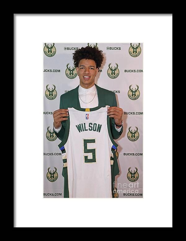 Nba Pro Basketball Framed Print featuring the photograph D.j. Wilson and Jason Kidd by Gary Dineen