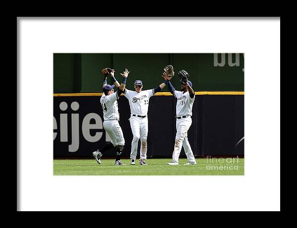 People Framed Print featuring the photograph Domingo Santana and Christian Yelich by Dylan Buell
