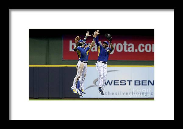 People Framed Print featuring the photograph Domingo Santana and Ryan Braun by Dylan Buell