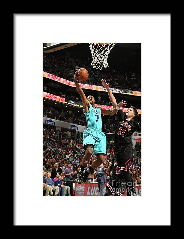 Nba Pro Basketball Framed Print featuring the photograph Doug Mcdermott and Ramon Sessions by Kent Smith