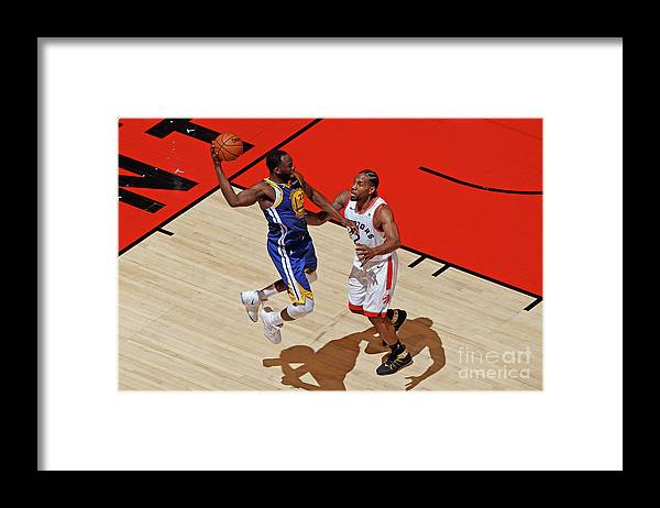 Playoffs Framed Print featuring the photograph Draymond Green and Kawhi Leonard by Mark Blinch